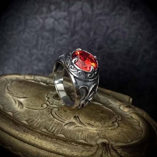 Bague pierre facettée rouge...
